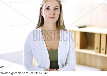 Business Woman Headshot While Working With Computer At The Desk In Modern Office. Designer Or Female