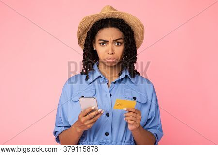Discontented African Girl Shopping With Smartphone And Credit Card, Having Problem With Mobile Appli