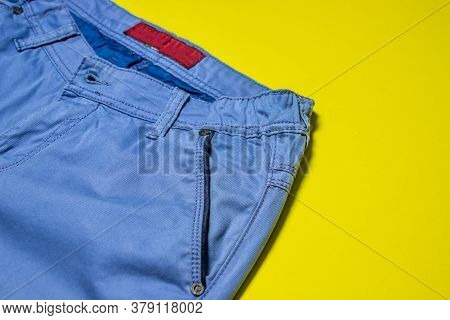 Classic pants. Blue classic trousers on a yellow background. Men's fashion. Modern style
