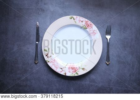 Cutlery And Empty Plate On Black Background Top Down