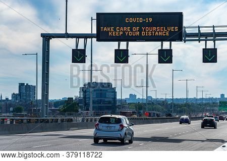 Montreal, Ca - 31 July 2020: Social Distancing Information Sign In French Language Above A Highway O