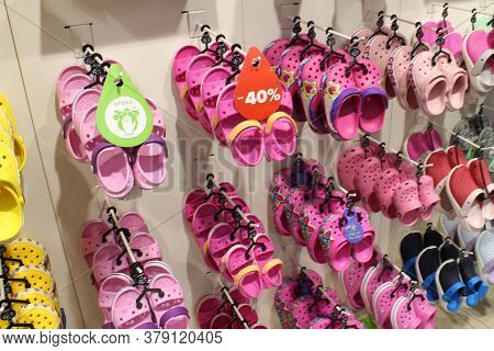Tampa, Usa - August 2, 2020: Rack With Lots Of Pairs Of Childrens Soft Rubber Sandals Or Crocs In Va