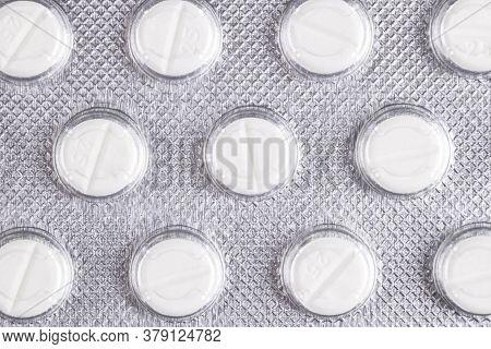 Macro Shot Pile Of Tablets Pill In Blister Packaging. Silver Aluminium Foil Blister Pack. Pharmaceut
