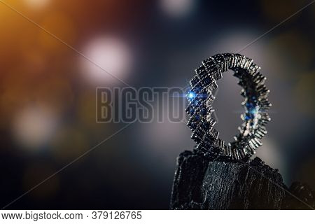 Ring Of The Jewelry With Small Blue Stones On Coal Background