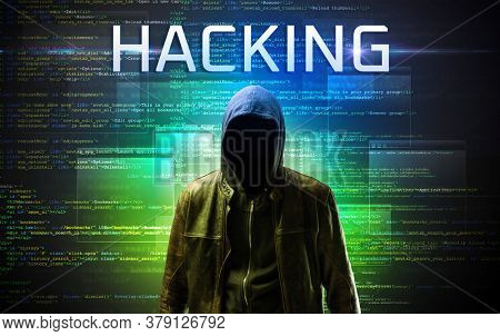 Faceless hacker with HACKING inscription on a binary code background