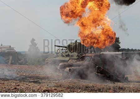 The Military Destroyed An Enemy Tank. Tank Is On Fire.