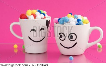 Couple of Happy Mug with smiley face. Happiness, smile, fresh and love Concept. Coffee for two