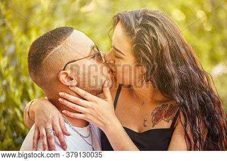 Young Love Couple Kiss At Sunset