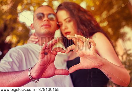 Loving Young Couple With Hands Form A Heart 2