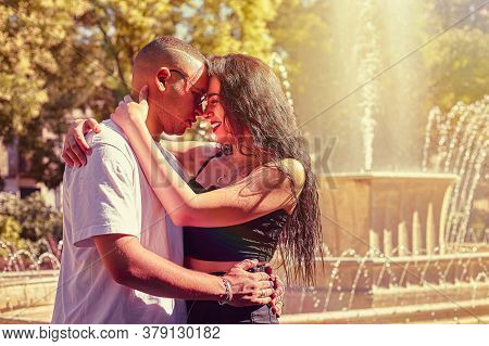 Loving Young Couple At The Park With A Fountain 2