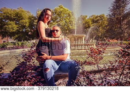 Portrait Young Loving Couple At The Park With A Fountain 4