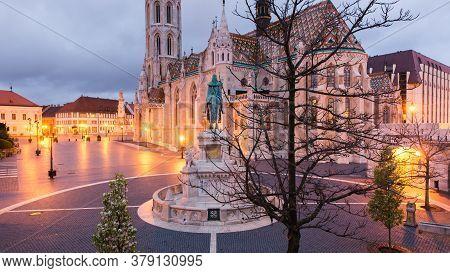 Catholic Matthias Church And Statue Of Saint Stephen On Fishermans Bastion In Budapest, Hungary On S