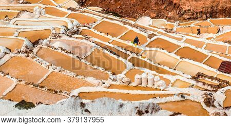 salt extraction in Peru. Workers at Salinas
