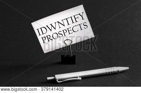 White Paper With Text Identify Prospects On A Black Background With Stationery