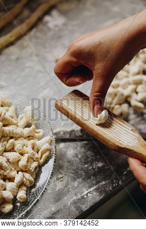 45 Degree View Of A Woman's Hand Preparing Homemade Gnocchi
