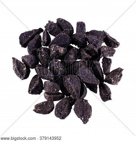Black Cumin, Folded In A Pile And Isolated On White Background, Macro Photo With Seeds Texture