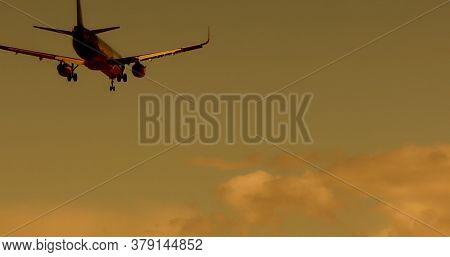 Big plane landing over sky background.