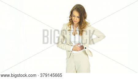 Menstruation pain or stomach trouble, woman hand holding her belly.