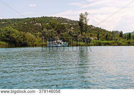 Green Hills With Forest Around Krka River In Beautiful Krka National Park, Croatia, Touristic Boats