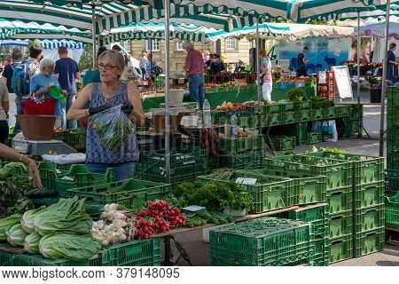 Esslingen, Bw / Germany - 22 July 2020: People Enjoy Buying Food At The Weekly Farmers Market In The