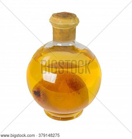 Pear In A Glass Bottle. Bottle With Yellow Tincture And Pear. Alcohol In A Round Bottle With William