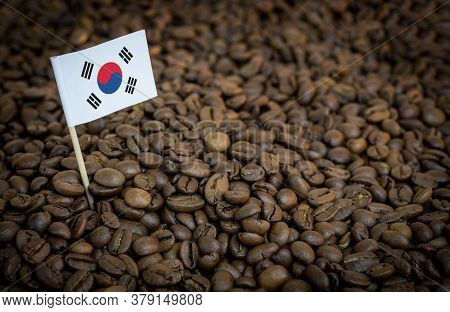 South Korea Flag Sticking In Roasted Coffee Beans. The Concept Of Export And Import Of Coffee