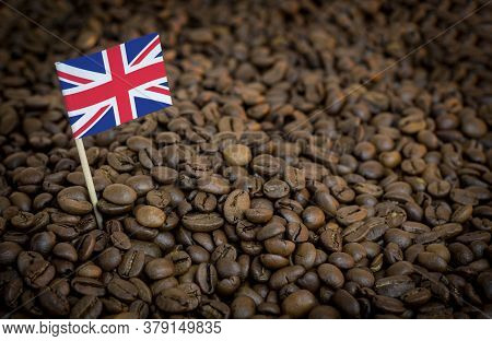 Great Britain Flag Sticking In Roasted Coffee Beans. The Concept Of Export And Import Of Coffee