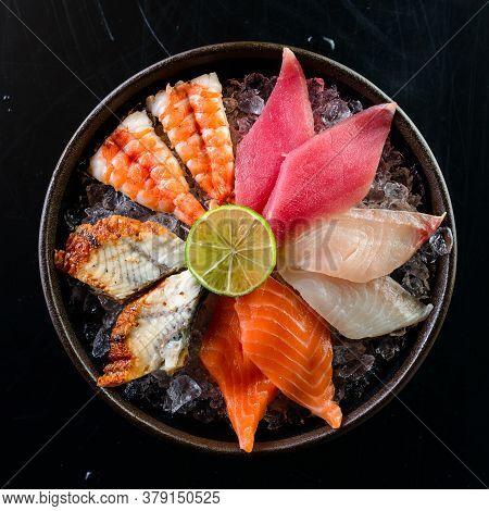 Japanese Gourmet Sashimi, Raw Sliced Fish, Shellfish Or Crustaceans, Salmon, Tuna Sashimi, Eel On Ic