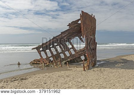 Rusted Skeleton Of The Shipwreck Of The Peter Iredale In Fort Stevens State Park In Oregon