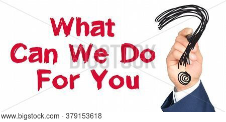 Hand With Marker Writing: What Can We Do For You. Hand Of A Businessman With A Marker.