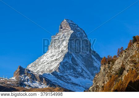 Stunning View Of The Famous Matterhorn Peak Of Swiss Alps From Zermatt Valley On Sunny Autumn Day Wi