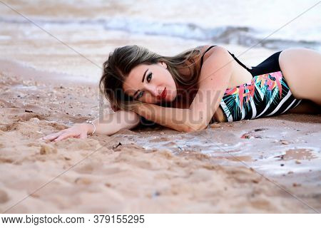 Happy Caucasian Woman On The Beach. Portrait Of The Beautiful Woman Close-up, The Wind Fluttering Ha