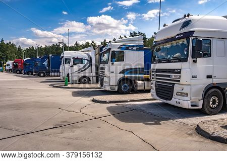 Minsk, Belarus -  July 2020: Trucks In A Row With Containers In The Parking Lot, Logistic And Transp