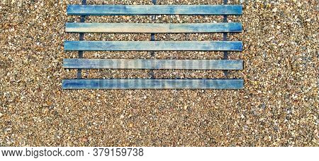 Wooden Boardwalk On The Beach. Sticks And Boards On Rocky Ground. Heel Protection From Damage. Summe