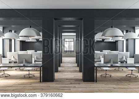 Loft Style Office Interior With Computers On Table And Daylight. Workplace And Corporation Concept.
