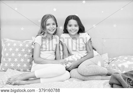 Always Cute. Happy Girls Sit On Bed. Beauty Look Of Little Girls. Small Girls Wear Home Clothing. In