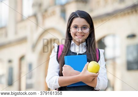Diet Cures More Than Doctors. Happy Schoolgirl Hold Apple And Book. School Break. Fruit Snack. Veget