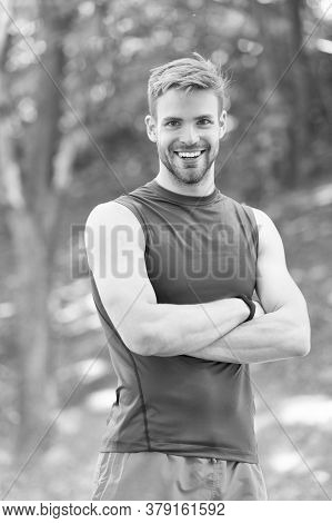 Sport Challenge. Confident And Physically Strong. Athlete Outdoors. Handsome Man Park Nature Backgro
