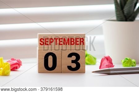 September 3. Date Of September Month. Number Cube With A Flower And Sign Wood On Diamond Wood Table