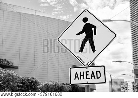 Miami, Usa - February 29, 2016: Traffic Sign Urban Background. Yellow Triangle Sign With Pedestrian