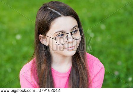 Little Girl Wear Vintage Rim Eyeglasses Green Lawn Background, Eyes Health Concept.