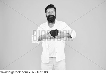 Romantic Guy With Red Heart Toy. Romance Concept. Celebrate Valentines Day. Romantic Hipster Sharing