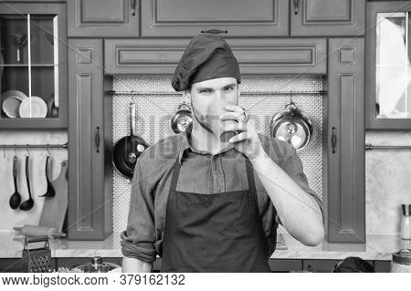 Man Chef Drink Tea. Handsome Man Is Holding A Cup. Skilled And Professional Barista. Man Work In Caf