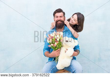 Moustache Are Classy. Happy Daughter Twirl Fathers Mustache. Little Child And Bearded Man Hold Flowe