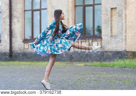 Girl Summer Dress Flutters In Motion Urban Background, Against Wind Concept.