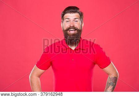 Emotional Bearded Hipster. Promoting Barber Services. Portrait Of Bearded Man Red Background. Brutal