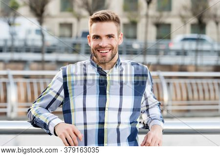 Receiving Care At Barbershop. Unshaven Guy Smile In Casual Style Outdoors. Barbershop. Barber Shop.