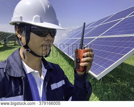 Construction Engineers Use A Walkie-talkie To Communicate With Technicians In Solar Power Plants.