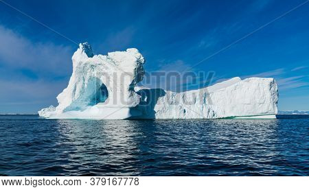 Climate Change and Global Warming Concept. Icebergs from melting glacier in icefjord in Ilulissat, Greenland. Photo of arctic nature ice landscape.