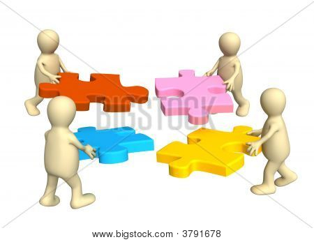 Four Puppets Holding In Hands A Puzzle